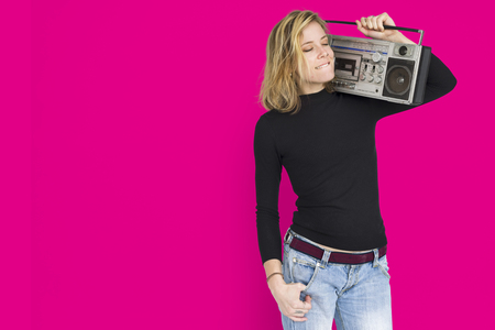 Young woman with radio concept Stock Photo
