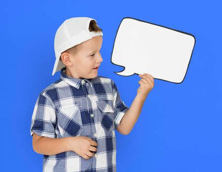 papercraft: Caucasian Little Boy Holding Chatbox Papercraft Stock Photo