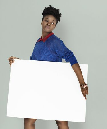 African Woman Holding Placard Stock Photo