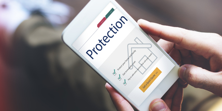 Protection concept on mobile phone Stock Photo