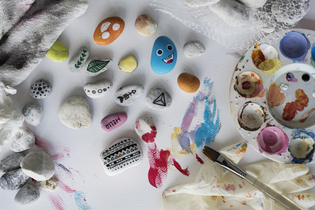 Painting Palette Pebbles Brushes White Table Stok Fotoğraf