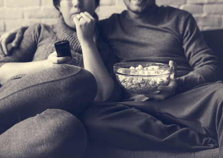 couple on couch: Couple Watching TV Home Relax Togetherness