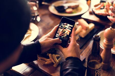 snapping fingers: Man Use Mobile Snap Food Photo