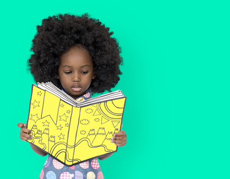 Little African Girl Reading a book Stock Photo