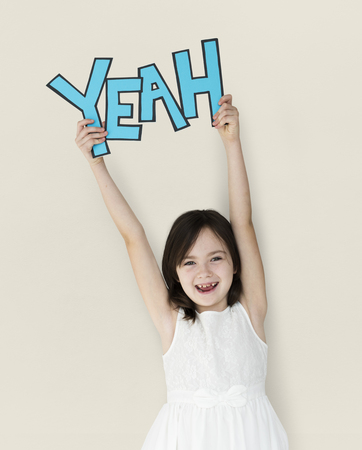 Girl with yeah word concept Stock Photo