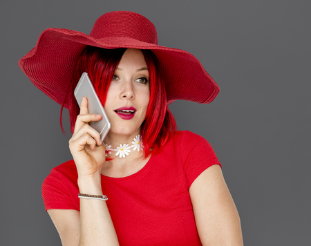 Caucasian Woman in a Red Dress Talking on the Phone