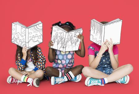 Little Children Reading Story Books Фото со стока