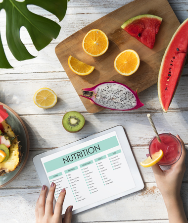 Woman with fruits and nutrition concept Stock Photo