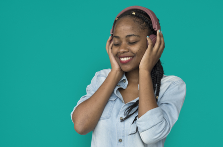 Young black girl listening to music headphones
