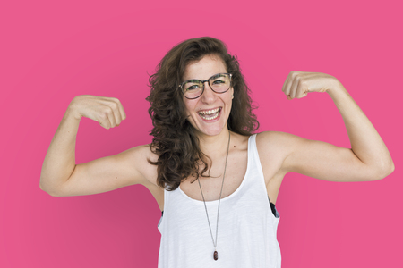 Cheerful woman with flexing pose