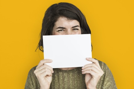 Woman holding a card with copy space