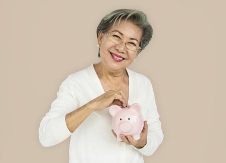 Senior Adult Hold Piggy Bank Concept