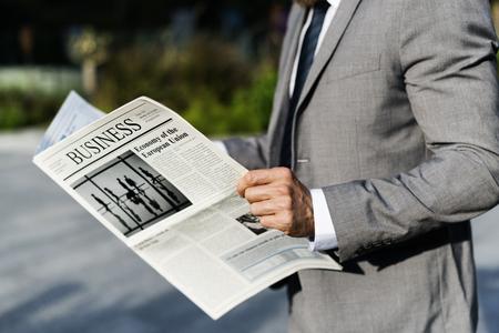 Businessmen Read Hands Hold Newspaper