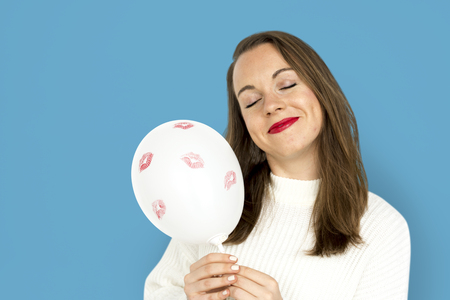 Young girl smiling holding a balloon