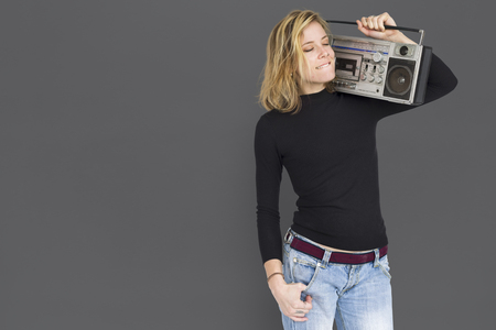 Portrait of woman carrying a radio