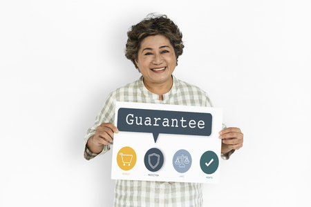 Mature woman holding a placard with guarantee concept