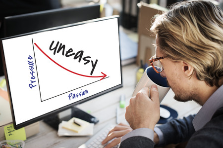 Businessman at work with pressure and uneasy concept