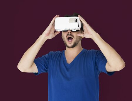visualizing: A man using a visualiaing reality gadget