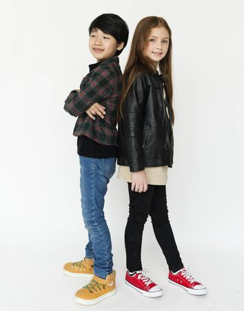 Boy and girl is in a studio shoot. Stock Photo