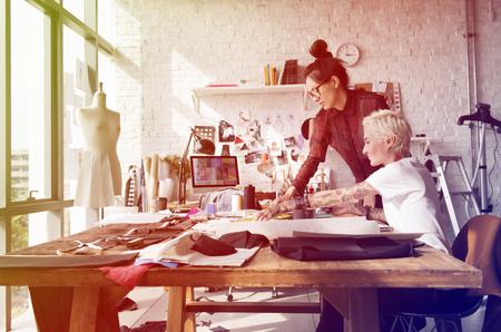 Fashion designer brainstorming and sharing ideas Stock Photo