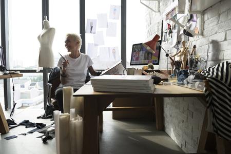 messy clothes: Fashion Designer Stylish Showroom Concept Stock Photo