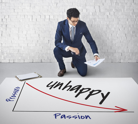 Businessman with unhappy graph concept