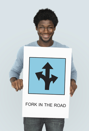 Man showing a placard with fork in the road concept Stock Photo