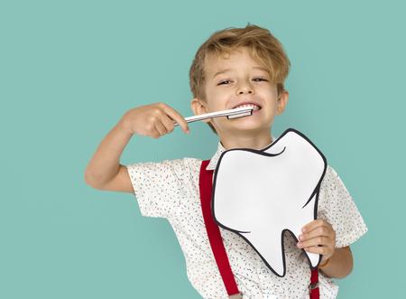 Little Boy Brushing Teeth Holding Papercraft Tooth Stock fotó - 76394391