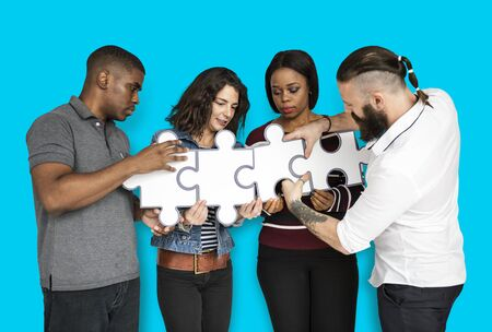 Team Building Piecing Jig saw Puzzle Stock Photo