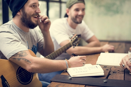 music lyrics: Men Play Guitar Write Song Music Reheaesal