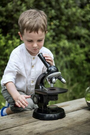 micro organism: Little Kid Experimenting Science Microscope