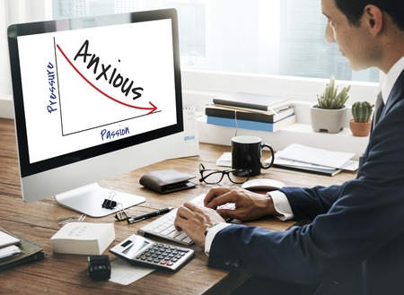 Businessman at work with anxious concept
