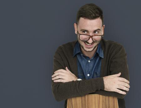 Caucasian Man Smiling Sitting Stock Photo