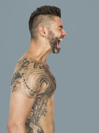 Caucasian Man Tattooed Chest Shouting