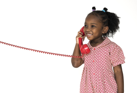 Little Girl Smiling Happiness Talking on the Phone Communication Stock Photo