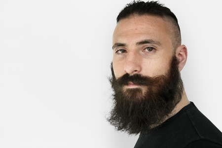 A man with beard and mustache in a studio shoot Stock Photo