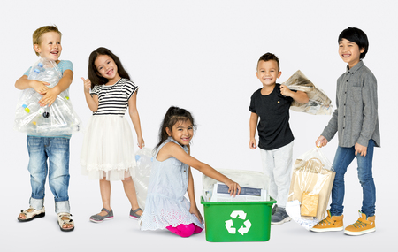 Ecology group of children separate trash for recycle