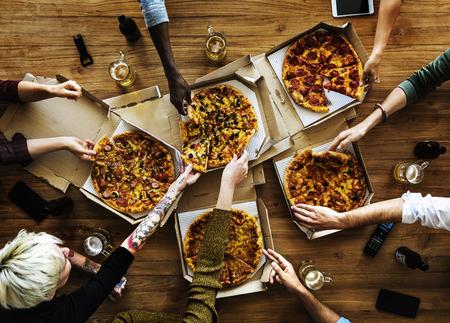 People Hands Grabbing Slice of Pizza Foto de archivo