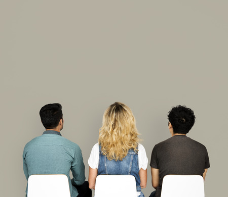 Rear view of three people sitting with copy space Stok Fotoğraf - 113594554