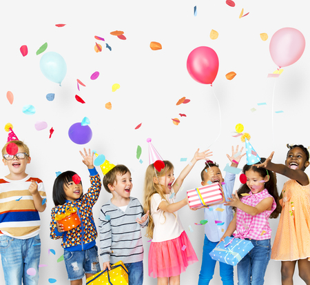 Group of kids celebrate birthday party together Фото со стока