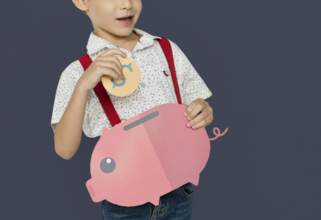 A Boy Saving Money Background Studio Portrait