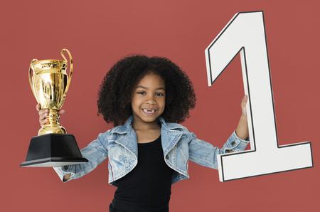 Little Girl Holding Trophy Happy 版權商用圖片