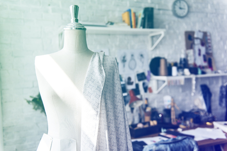 Fashion designer workspace with the messy objects