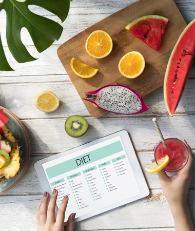 Woman with fruits and diet concept Stock Photo