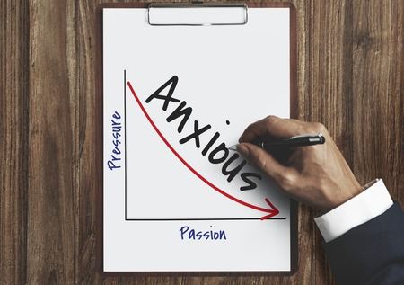 Businessman with anxious graph concept