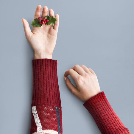 Hand Holding Mistletoe Christmas Decoration Stock Photo