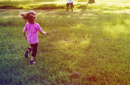 Little Girl Running in Grass Field Park Outdoors