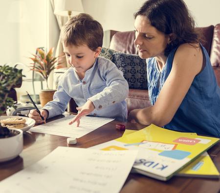 Mom Teaching Her Son Doing Homework Stock Photo