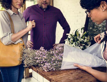 People Buying Bouquet of Flower at Flora Shop Banco de Imagens