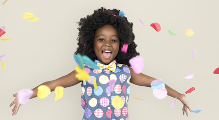 Cheerful kid with confetti